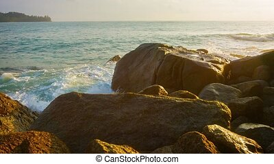 Tropical Waves Splash over Rocks in the Late Afternoon