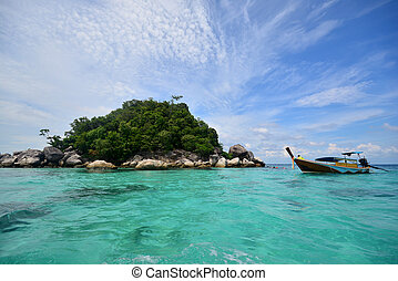 Tropical white sand and blue sea with blue sky at Andaman Sea. Lipe Island, Satun, Thailand.