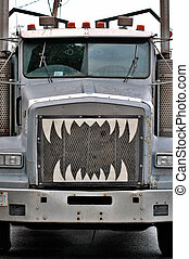 Trouble in the Rearview - Big truck with teeth.