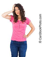 Troubled cute brunette posing