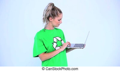 Troubled environmental activist using a laptop on white...