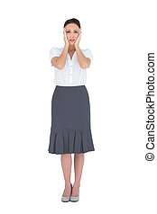 Troubled gorgeous businesswoman posing on white background