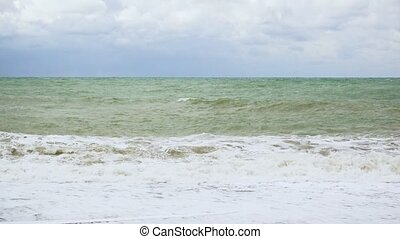 Troubled ocean with waves to shore - Troubled ocean with...