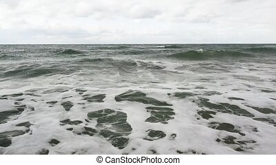 Troubled sea with small waves