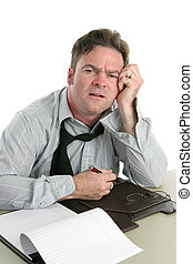 Troubled Worker - A tired looking office worker having ...