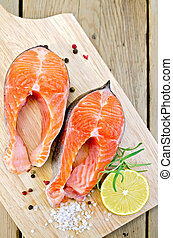 Trout on board with lemon - Two pieces of trout with...