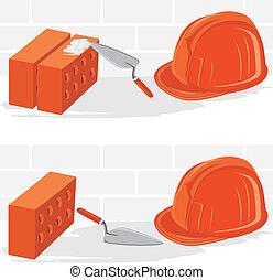 Trowel, bricks and safety helmet