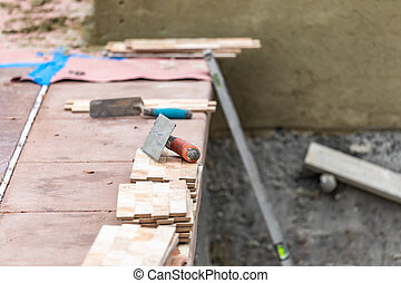Trowels and New Tile At Pool Construction Site.