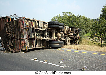 Truck Accident - A view of an overturned truck on an highway...