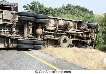 Truck Accident - A view of the rear wheels of a skidded ...