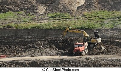 Truck and excavator working in quarry