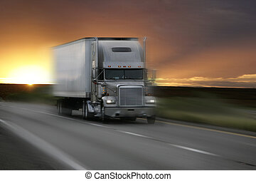truck at sunset with motion blur