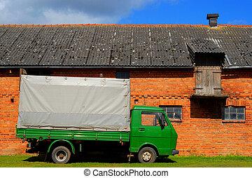 Green truck at the farmyard