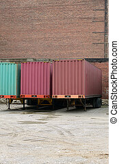 Truck cargo transport trailers parked at depot