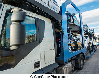 Truck carrier loaded with cars - Truck carrier loaded with...