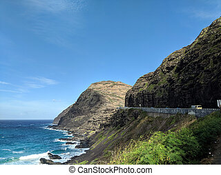 Truck Drive along cliffside mountain highway at Makapuu with...