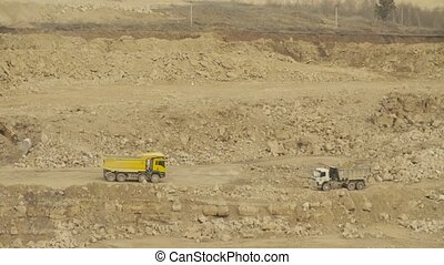 Truck driving in quarry - Truck driving in a quarry. Work in...