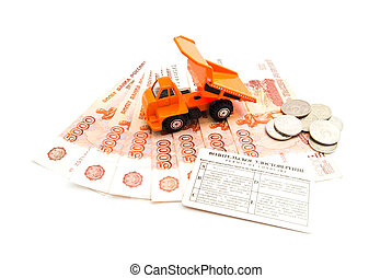 truck, driving license and banknotes