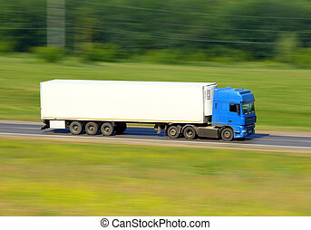 truck driving on a road