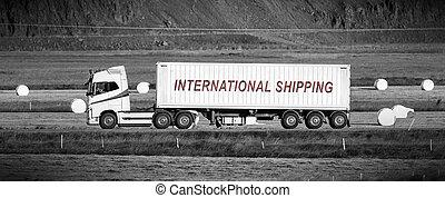 Truck driving through a rural area - International shipping