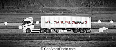 Truck driving through a rural area - International shipping