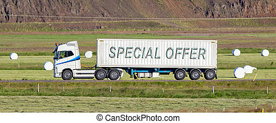 Truck driving through a rural area - Special offer