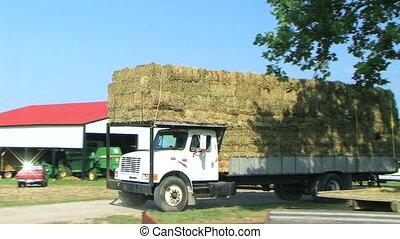 Truck Hauling Hay Bales - Truck hauling load of hay bales.