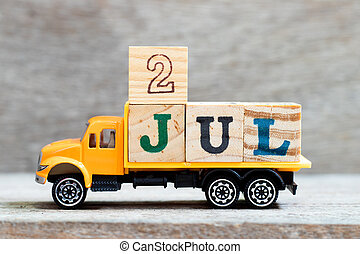 Truck hold letter block in word 2jul on wood background (Concept for date 2 month July)