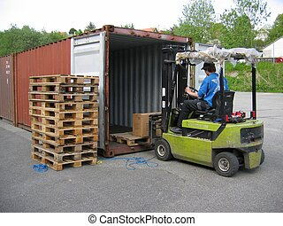 Truck Lifting Pallet - A truck with a driver lifting a...