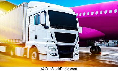 Truck . Loading cargo plane .