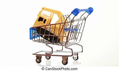 Truck-mounted crane toy inside shopping cart turning around...