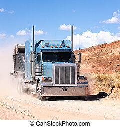 truck on a desert - truck moving on a desert