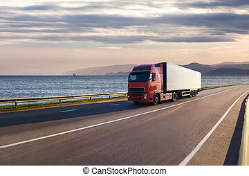 Truck on a road near the sea - Red truck on a road near the ...