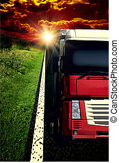Truck on asphalt road under storm sky with clouds