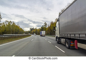 Truck on freeway road, cargo transportation concept