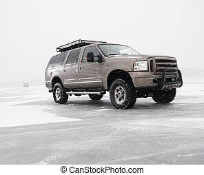 Truck on frozen lake.
