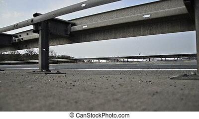 truck on german autobahn/highway driving away on a bridge