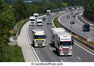 truck on highway - truck on a three highway. symbolic photo ...