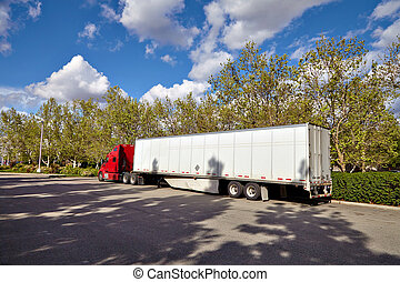Truck on road with white blank container, blue sky, cargo transportation concept