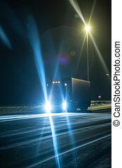 Truck on winter night on the highway