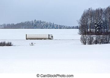 Truck on winter road - Truck on snowy lan road at winter