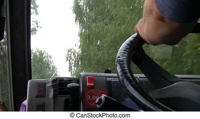 Truck or van driver driving