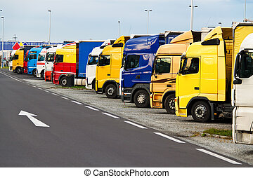 Truck Parking on - Many trucks in a parking lot. Ban at the...