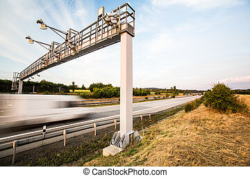 truck passing through a toll gate on a highway