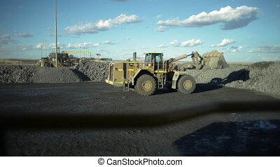 Truck picking up rocks shot - A medium shot of a truck...
