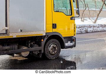 truck rides on a city street