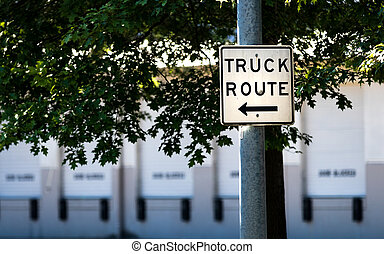 Truck route sign on a steel post