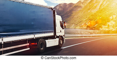 Moving truck on the highway with lake landscape