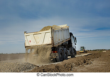Truck tipping gravel
