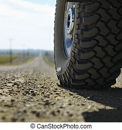 Truck tire on road.